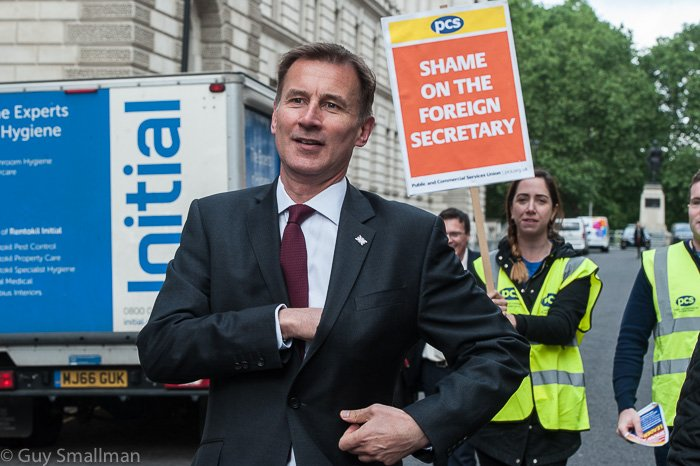 Oops... @Jeremy_Hunt tries & fails to slip past a @pcs_union picket line outside his own department this morning. Cleaners are on strike against appalling treatment by private contractor Interserve. Im guessing that this was not on his wish list of photo ops? #JeremyHunt #PCS