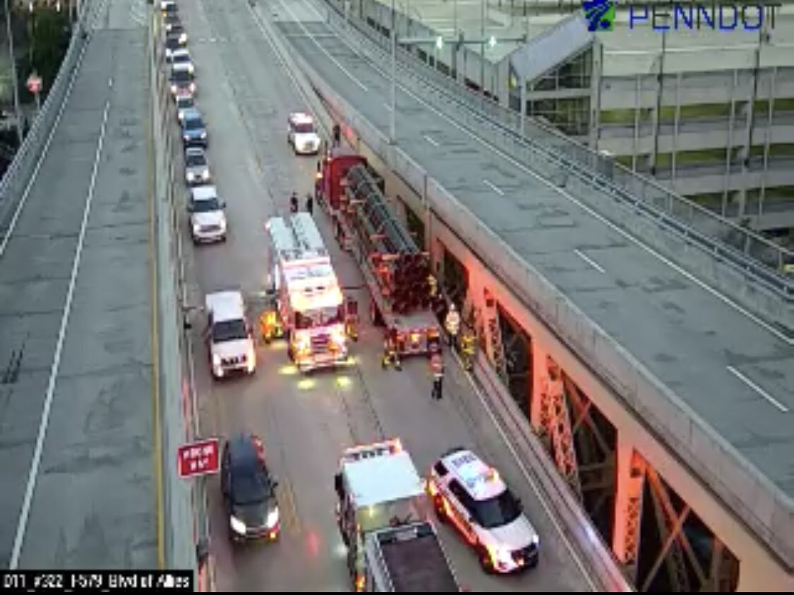 BREAKING: A car is pinned on the other side of this tractor trailer. Outbound lanes are closed on the Liberty Bridge.  We don't know yet about injuries. We'll have updates on the situation on @KDKA and here on Twitter.