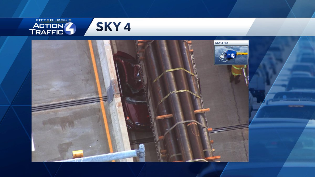 Wow! Sky 4 is over the scene of this bad crash on the Liberty Bridge. This car is smashed against the concrete barrier by this flatbed truck. Inbound traffic is crawling along in one lane. NO outbound traffic is moving through. #wtaetraffic
