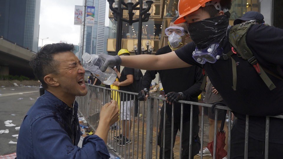 Earlier I said our team was tear gassed as we filmed next to a group of #HongKong protestors. Our awesome photog @CBSrandy grabbed this still from the vid. These super kind protestors helped douse my eyes. Watch @CBSEveningNews tonight to see how it happened. @CBSNews is here.