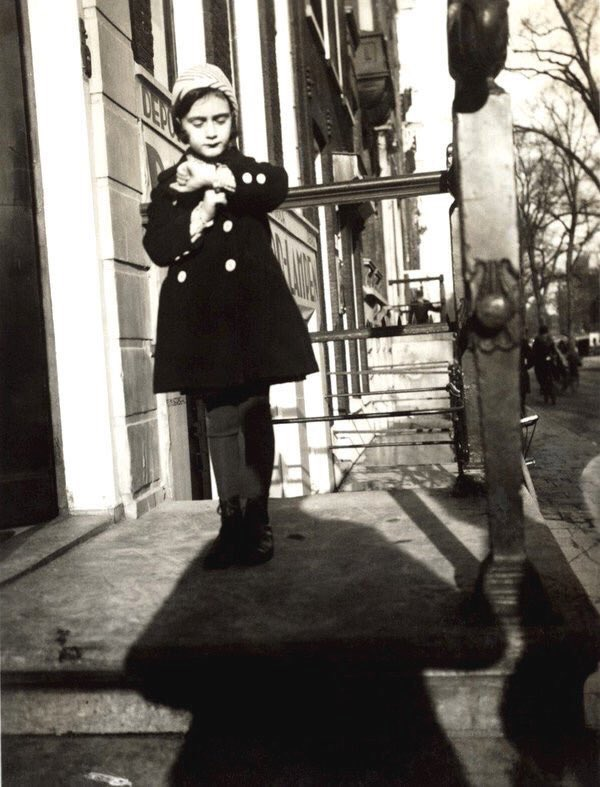 Anne Frank (aged 5) standing on the steps of her father's office building in Amsterdam (1934) #AnneFrank90 <br>http://pic.twitter.com/uQo9UdNZPc
