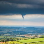 Image for the Tweet beginning: Wow! Multiple funnel clouds and