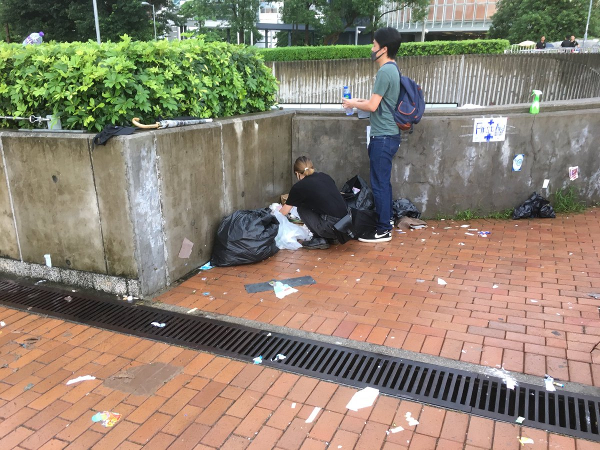 Mostly what people are doing is cleaning up the rubbish left behind when they were chased away by police yesterday & scavenging still-usable supplies. #HK people are incredible.