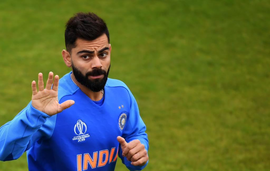 As soon as the #IndvsNZ match starts and climate change ⛈  it show that may be rain ☔Virat Reaction ; -
