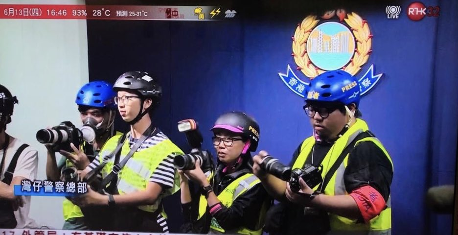 Top trolling from HK reporters: wearing helmets and gas masks to an indoor police press conference