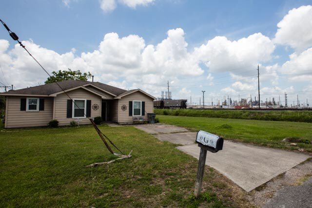 This is a story about neighbors.   See that house?  Years ago, a family bought it for $60,000.   See the oil refinery next door?  It is owned by a Saudi Arabian company that made $111 billion profit last year, almost twice as much as Apple.