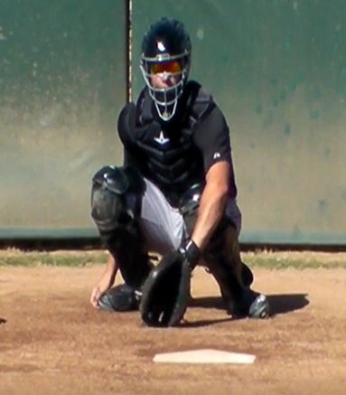 Good starting position for glove when you are working with catchers to get under & up through the low stri-ball. Glove on ground with thumb at 6 o'clock.