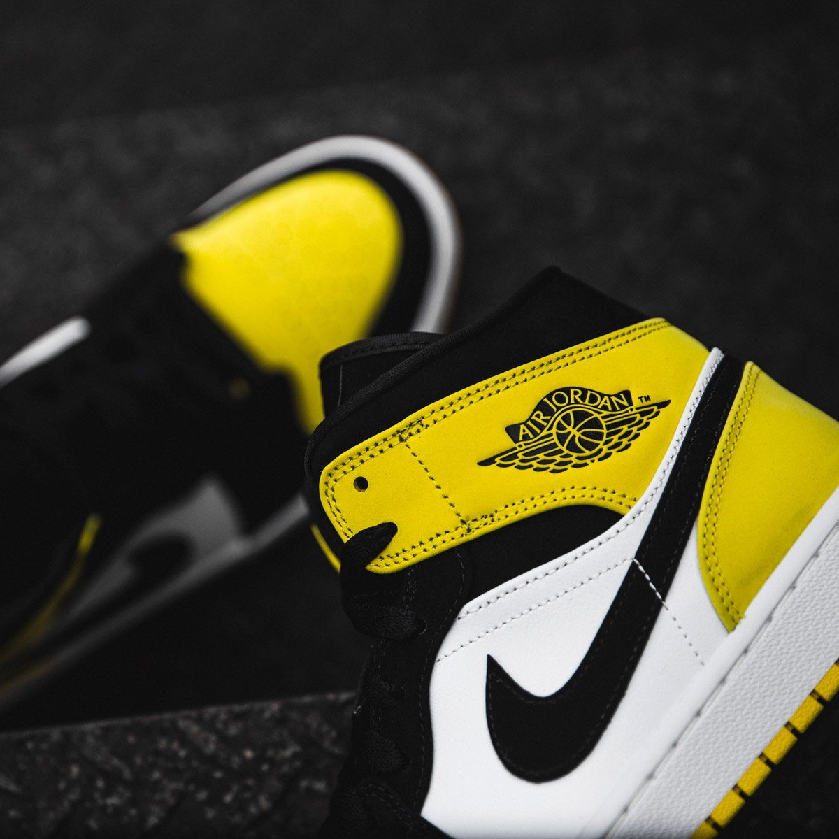1ac13b7d92 The Air Jordan 1 Mid 'Yellow Toe' is now available in SNIPES stores and