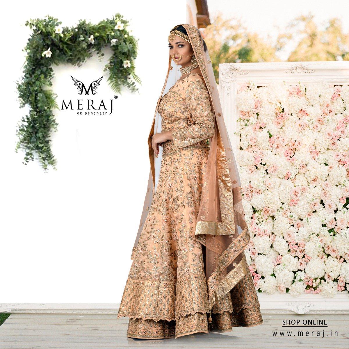 63bf567ec1 An astonishing Light Peach coloured Lehenga Choli exhibiting the real  beauty of silk and net fabrics