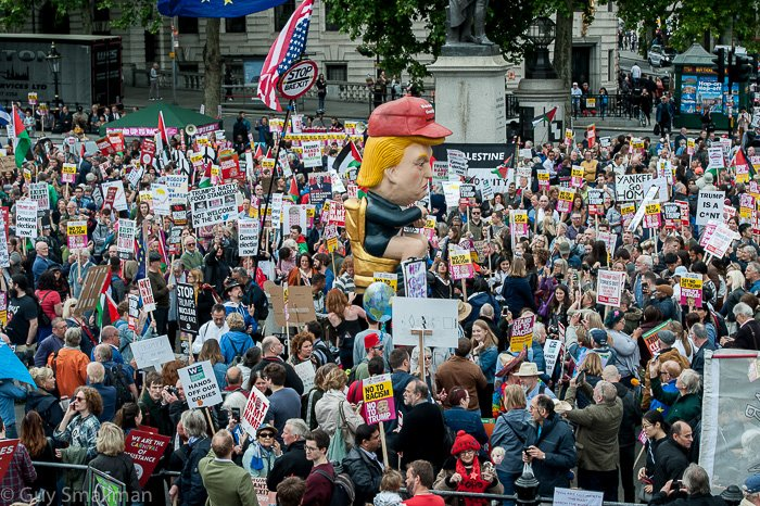 Crowds now building up in the square for the official Trump welcome. I mean seriously... rolling out the red carpet for this moron?!? Well its not like we werent already the laughing stock of all Europe... #TrumpUKVisit