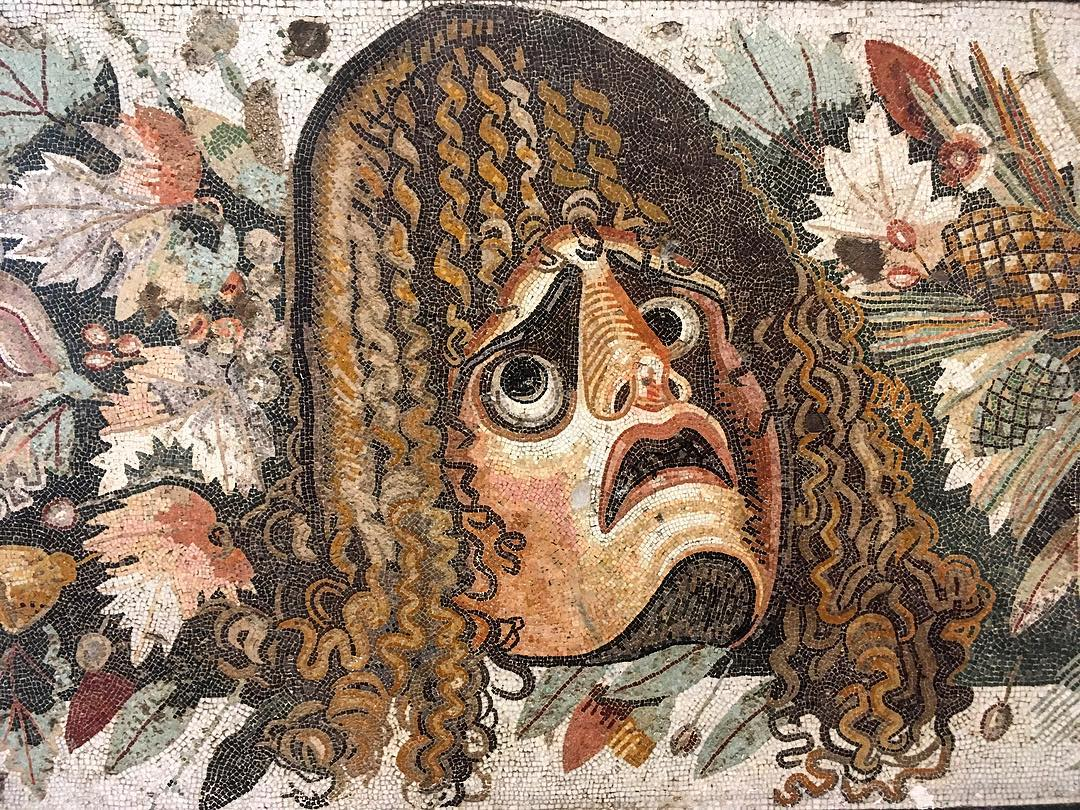 A roman mosaic representing a tragic theatrical mask