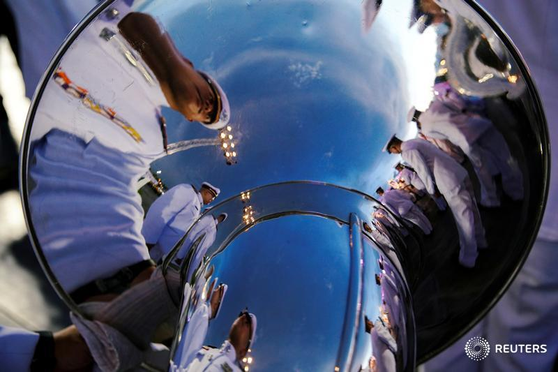 Officials are reflected in a musical instrument as they gather outside the Grand Palace to celebrate the 41st birthday of Thai Queen Suthida in Bangkok. More photos of the day: https://reut.rs/2HV1LLW  📷 @Athit_P