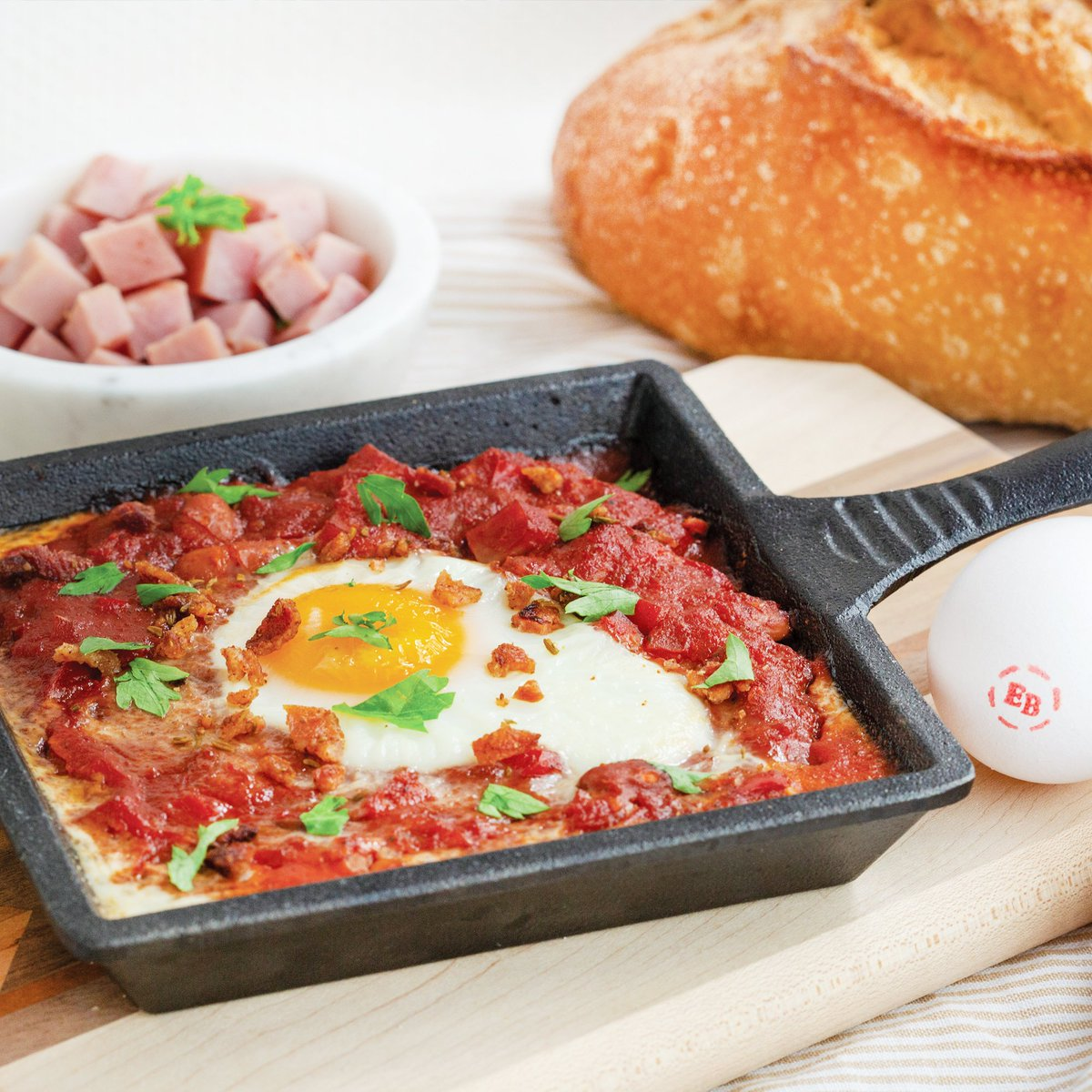 Our Honey Ham & Bean Chili Skillets with Bacon Cumin Dusted Easy Eggs recipe should be your next cooking adventure...we promise you won't regret it! 🍖 Recipe on our website! #madewithEB #onlyfeedmeEB #eggs #putaneggonit #oklahoma #okc #tulsa #oklahomacity #tulsaoklahoma