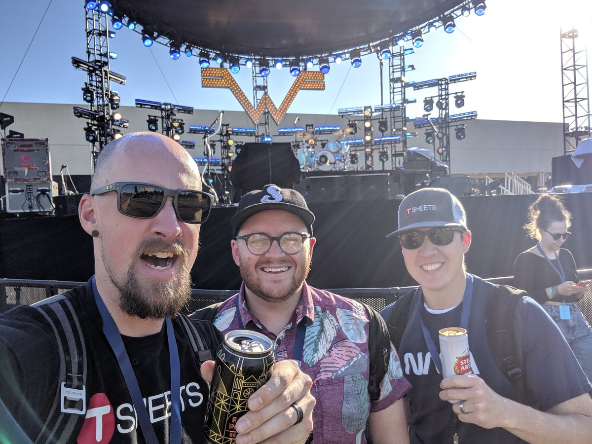 Drinking a beer, waiting to see Weezer! #TSheets #WWD2019