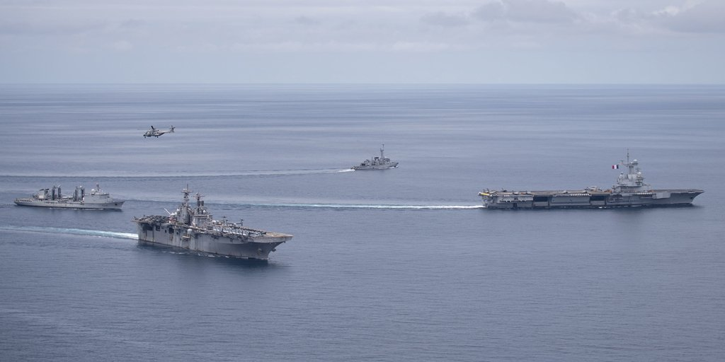 USS Boxer (LHD 4) breaks away from formation steaming with FS Charles de Gaulle (R 91) and its escorts, June 7. (U.S. Navy/MC3 Alexander C. Kubitza)