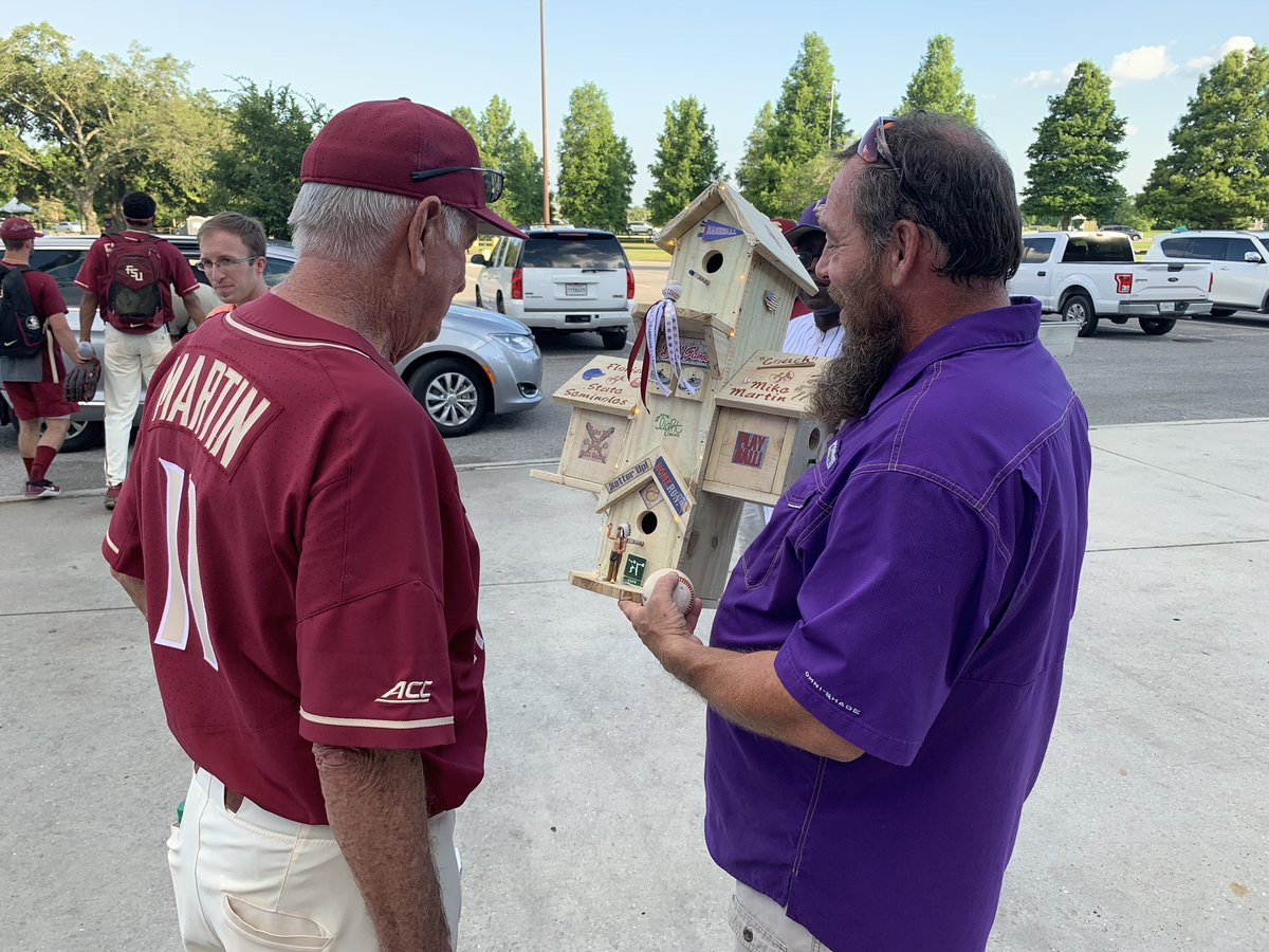 Pretty cool. LSU fan approaches Mike Martin with a homemade gift. – at Alex Box Stadium/Skip Bertman Field