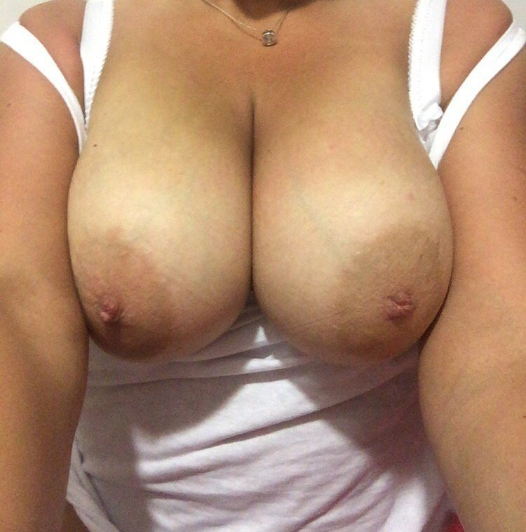 Tanned big natural tits