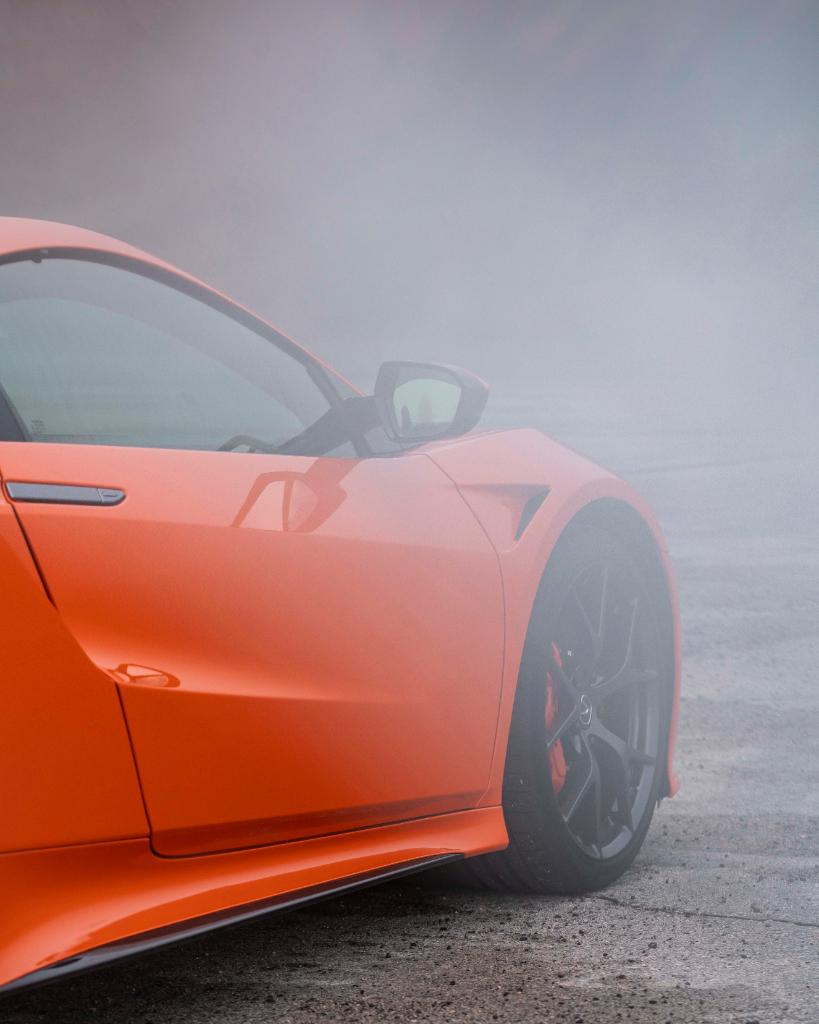 Unmistakable even in the mist. #NSX Thermal Orange. 📸 @jbh1126