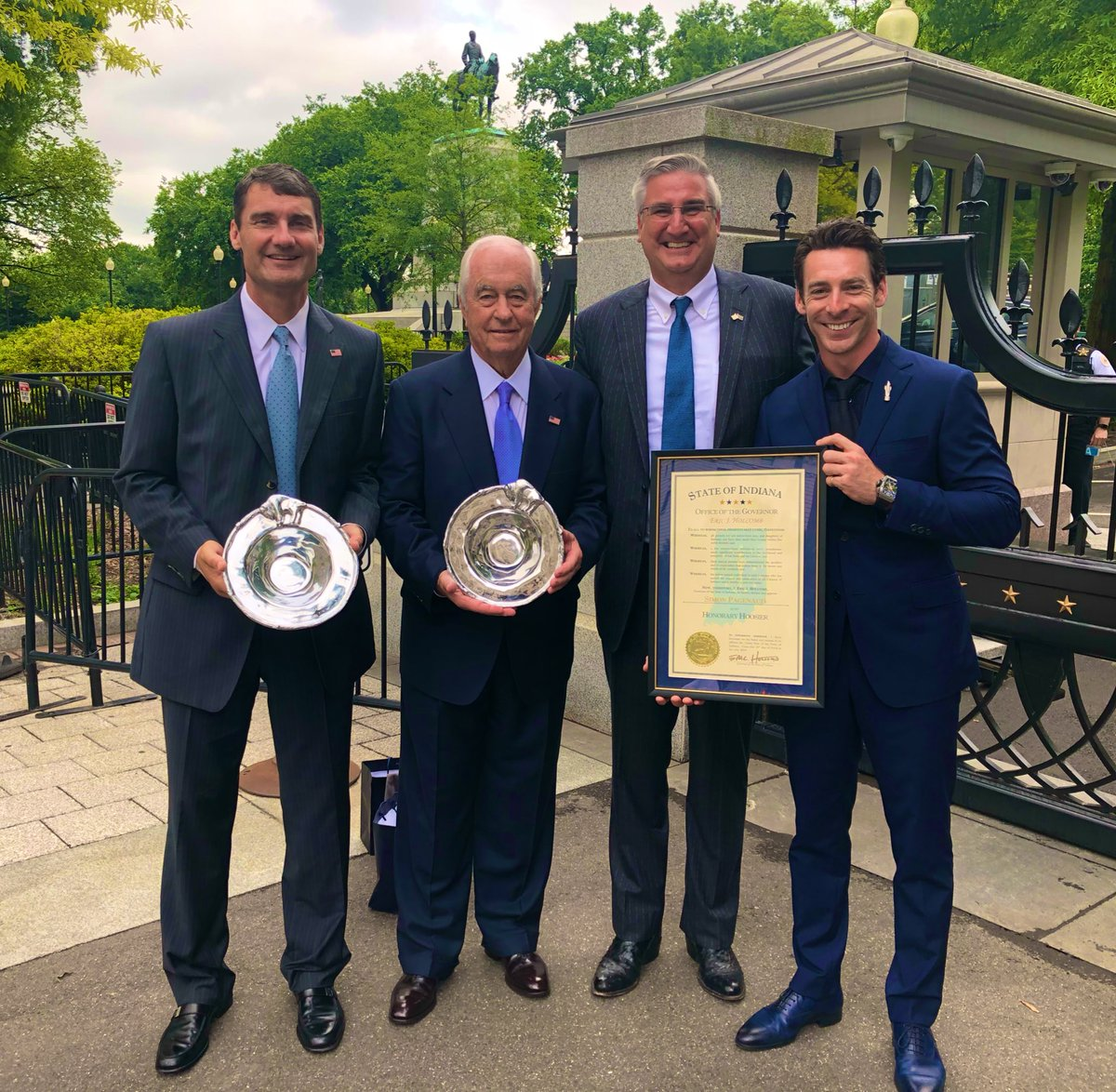 "One of the most genuine presentations I've seen. In an impromptu moment outside the gates to the @WhiteHouse, Indiana Gov @GovHolcomb presents Indiana gifts to ""The Captain"" Roger Penske & @TimCindric! And makes @IMS #Indy500 Winner @simonpagenaud an Honorary Hoosier!"