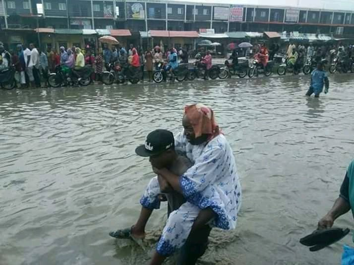 Aboki's Collect Money To Carry People Across Flood In Badagry