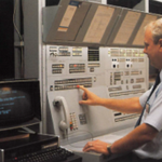 A GSA contract project manager monitors status of traffic on a control board of an integrated network circa 1987, which provided telephone svc to federal agencies in Washington, DC. See GSA's modern telecomms products & services offerings: https://t.co/Xyl7uMMutH #GSAat70