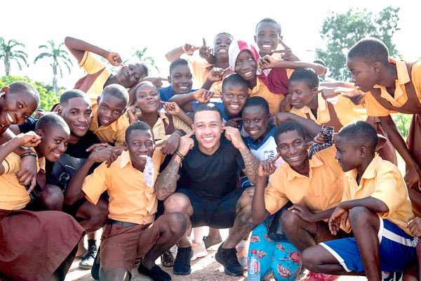 Dutch player, Memphis Depay is in Ghana to partake in charitable works. He visited the School of Deaf and Dumb in Cape Coast alongside Bisa Kdei. He also decided to wear their school uniform with them to be in touch with them.  He is half-Ghanaian.