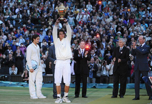 The day Rafa ended Federer's 5 Wimbledon titles winning streak.   The day Rafa ended Federer's 65 match winning streak on grass.   The day Rafa beat arguably the greatest grass court player ever to win his maiden Wimbledon title.  THE GREATEST MATCH IN TENNIS HISTORY <br>http://pic.twitter.com/XpObW0VG02