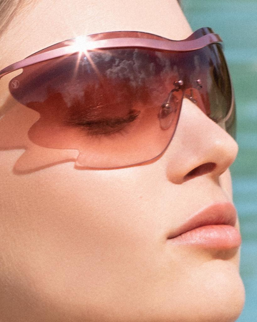 Sleek in the sun. The new #LouisVuitton Bohemian Vuittony sunglasses also come in the sportier Mask model. Explore the new #LouisVuitton Women's Sunglasses Collection at http://on.louisvuitton.com/6018ESoD2