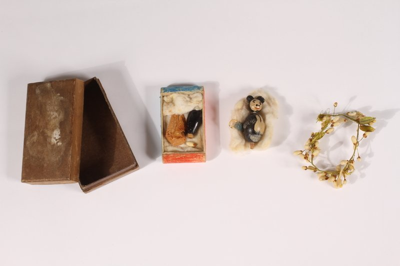 Pierre Seel's mother made this small memento out of a toy and her wedding veil while her son was imprisoned. In 1941, Pierre was arrested, tortured, and sent to a concentration camp in Alsace, France, for being a gay man. 1/5
