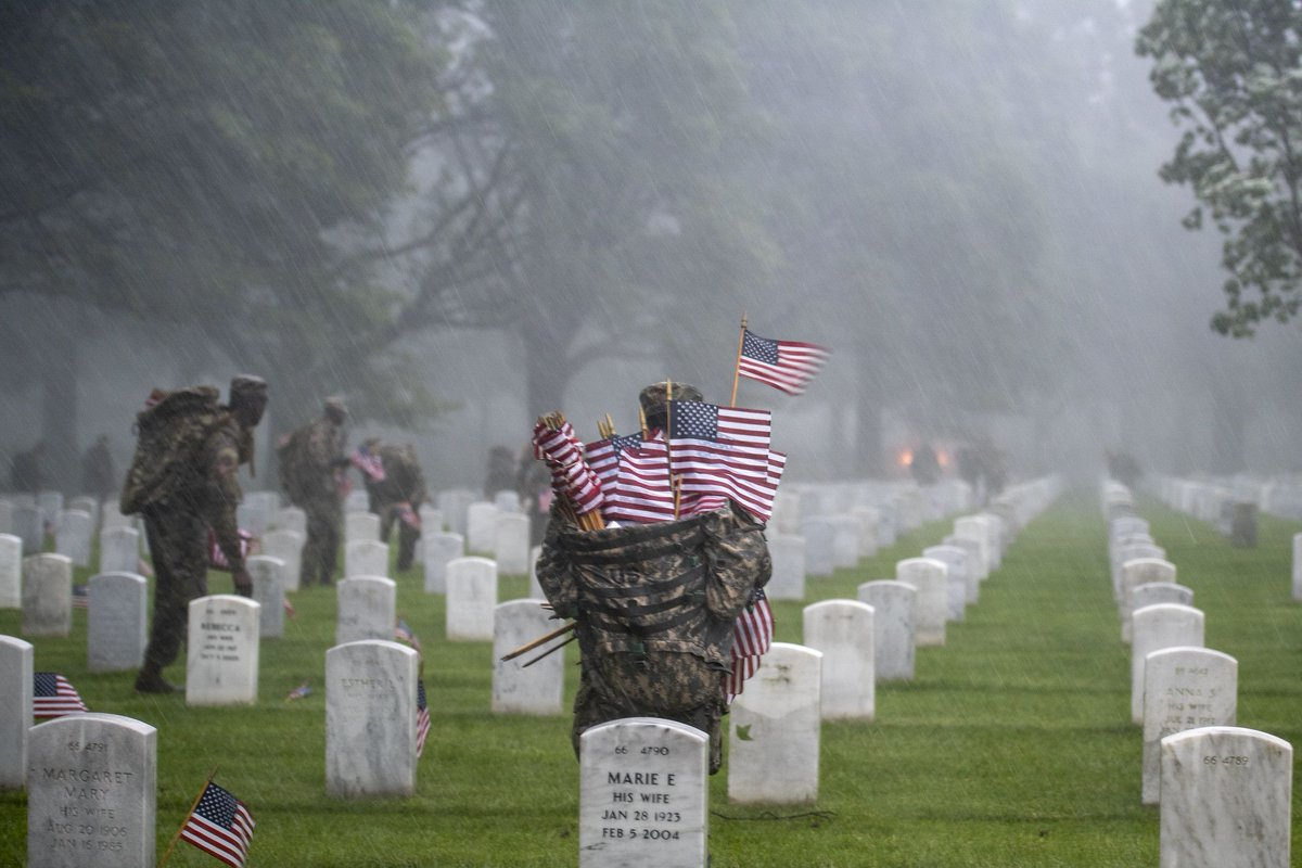 On this #FlagDay, we recall soldiers from the 3d U.S. Infantry Regiment (The Old Guard) who braved through heavy rain and wild winds to place U.S. flags at headstones as part of 'Flags-In' at Arlington National Cemetery on May 23, 2019. (U.S. Army Photo by Elizabeth Fraser)