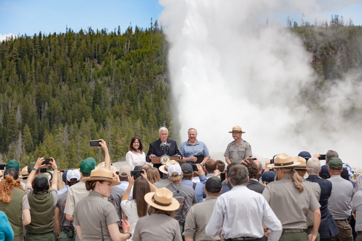 Vice President Pence speaks at the podium during an Old Faithful eruption.
