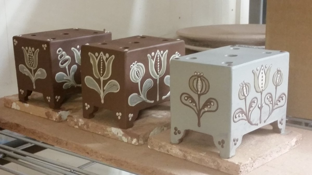 More beautiful work from my sweet wife @hannahmcandrew who, in spite of the agony of two abscesses in her mouth, has constructed and decorated these flower bricks today, as well as tend to two babies. She's an amazing woman.   #slipware  #fitchandmcandrewonline  #hannahmcandrew