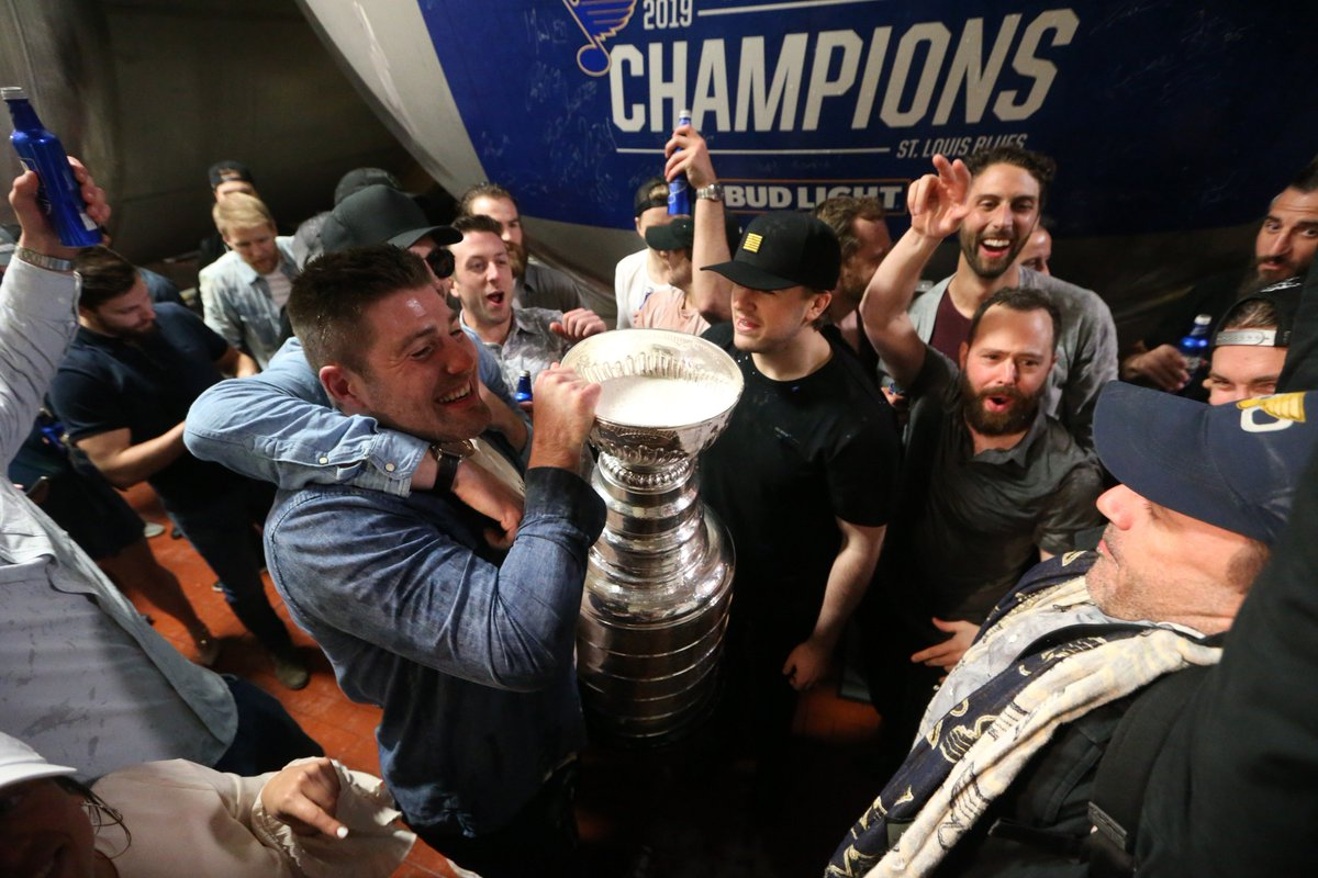 The Blues and Jon Hamm (right) soaking in the Bud Light.