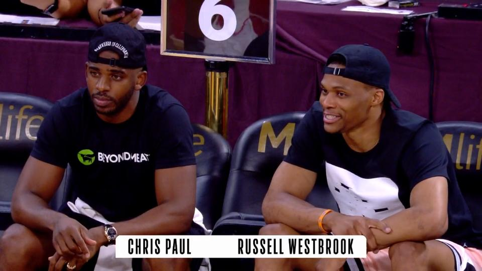 Russell Westbrook taking in the WNBA season with other NBA stars