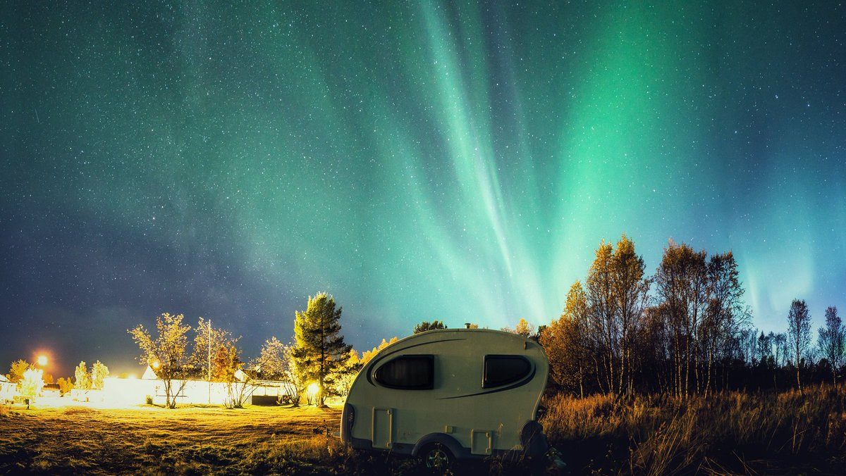Autumn night in the neighbourhood.  The aurora covering the sky, the Milky Way just barely visible to the eye (yes, right here in town) and an abandoned little camper. <br>http://pic.twitter.com/XQqM8s5xIT