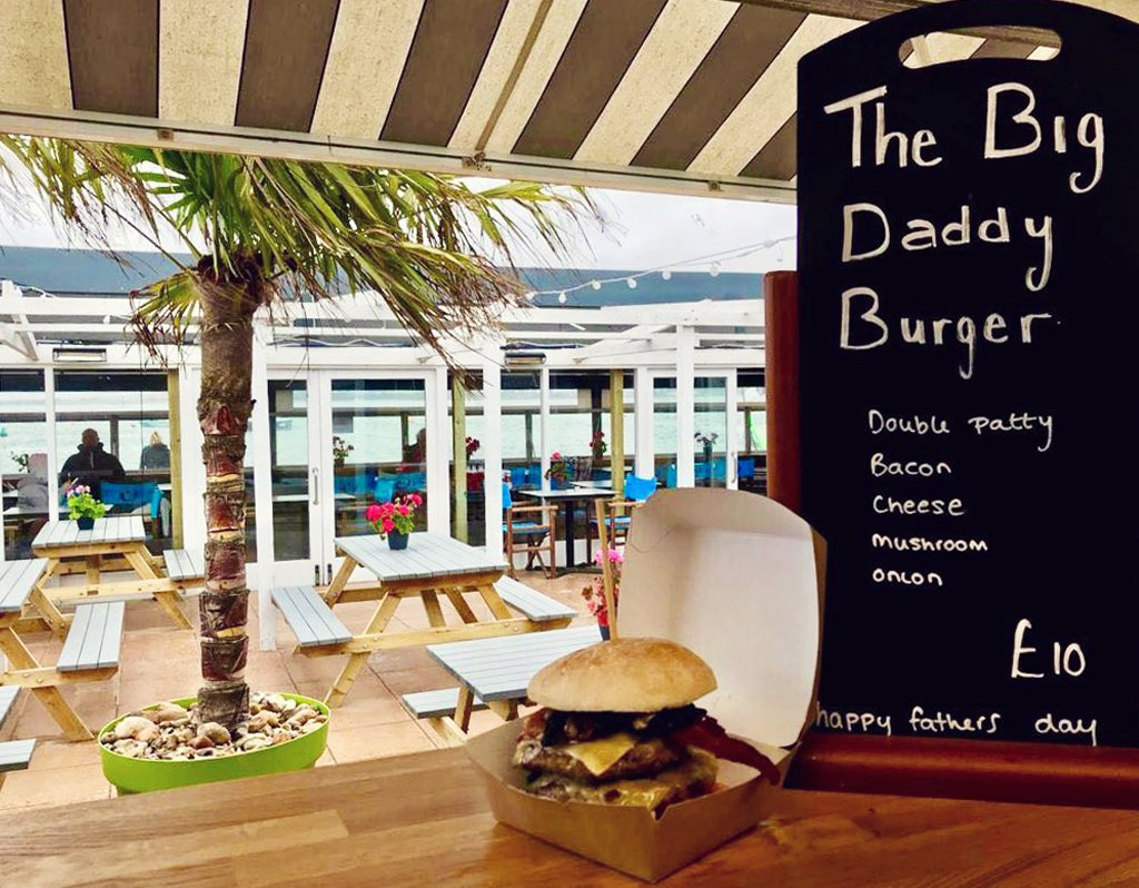 The rain isn't dampening our spirits down at Mudeford!    With father's day tomorrow we've got a special burger on the grill  for the weekend   The Big Daddy Burger   Double patty, bacon, cheese, mushroom & onion    #beachlife<br>http://pic.twitter.com/Ey6h8ItQsA