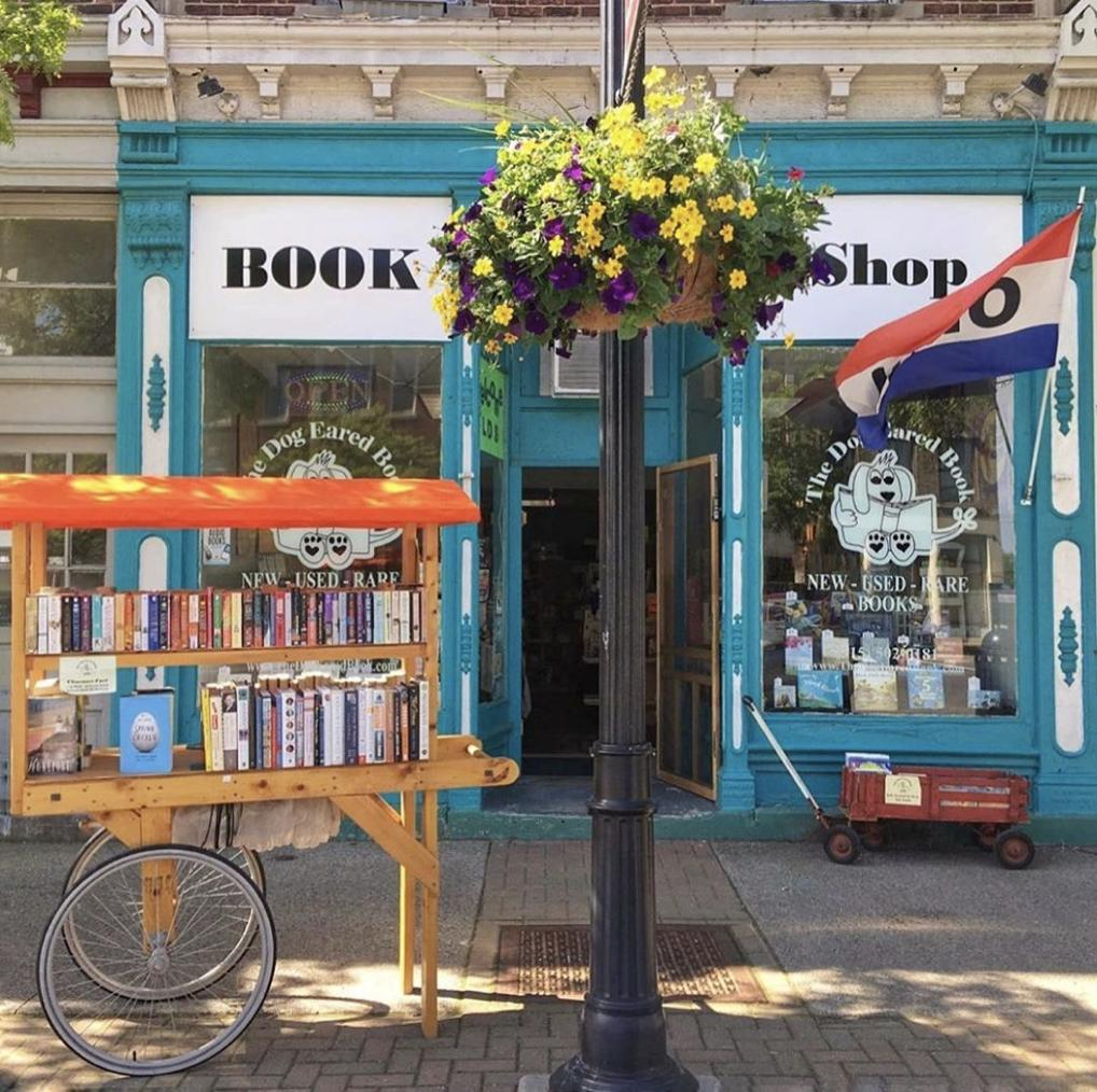 This picture! 📖🌼 How perfect is this summertime dream created by The Dog Eared Book? It's hard to imagine a better place to spend the day. Find this acclaimed indie bookstore in #Palmyra, NY! 📸 @DogEaredBookNY