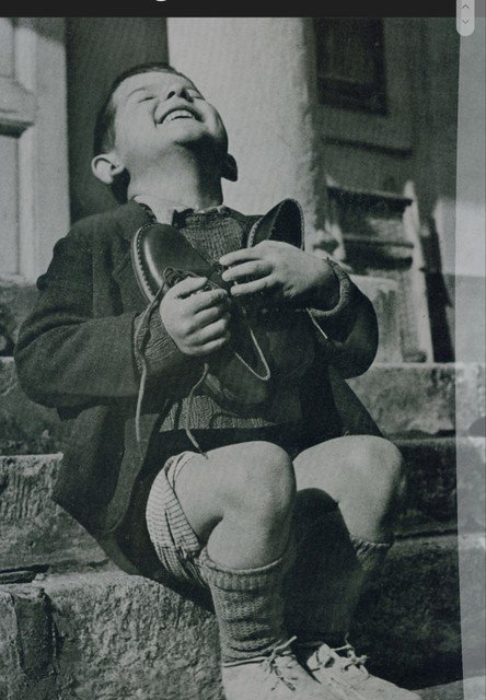 #Saturday #SaturdayThoughts #History #Photography #Pictures #Retro #EveryDay #Love  A young Austrian Child gets a new pair of shoes during #WW2