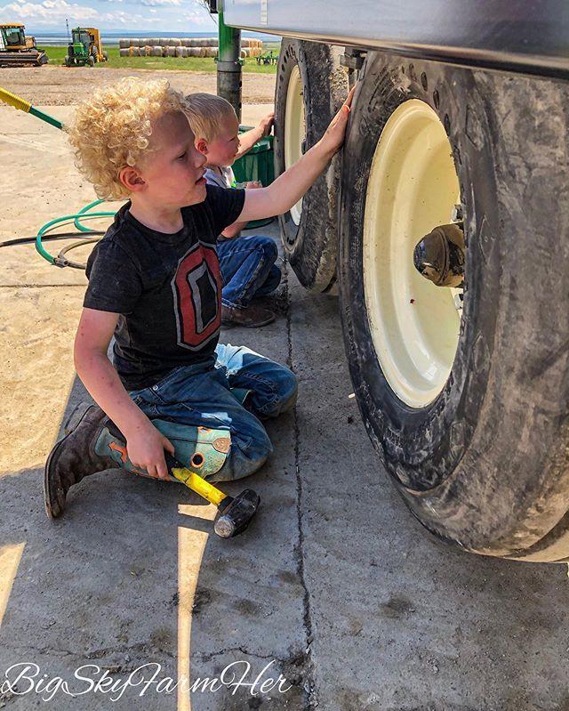 """Helping"" check wheel bearings ... getting ready for haying season. #farmkids #farmkidlife #momlife #mom #farmmom #boymom #farmlife #haying #sweetsummertime☀️ #montana #farmher #femalefarmerproject http://bit.ly/2MPLgW2"