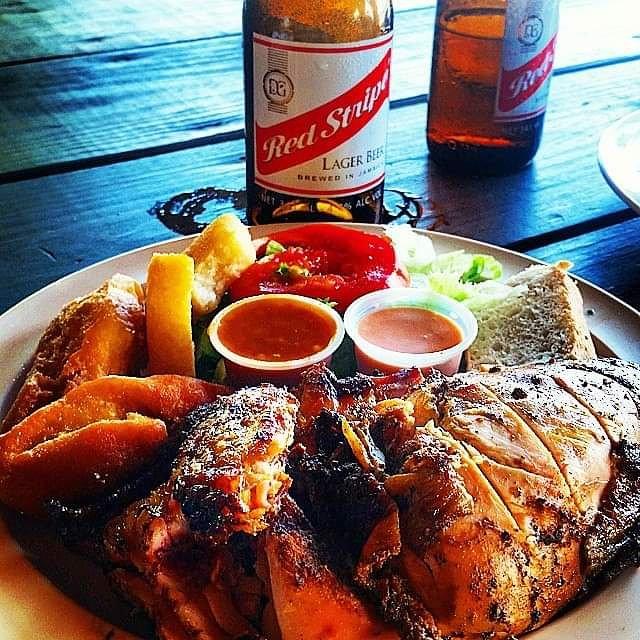 Red Stripe Beer and jerk chicken<br>http://pic.twitter.com/6e3gcXbq7R