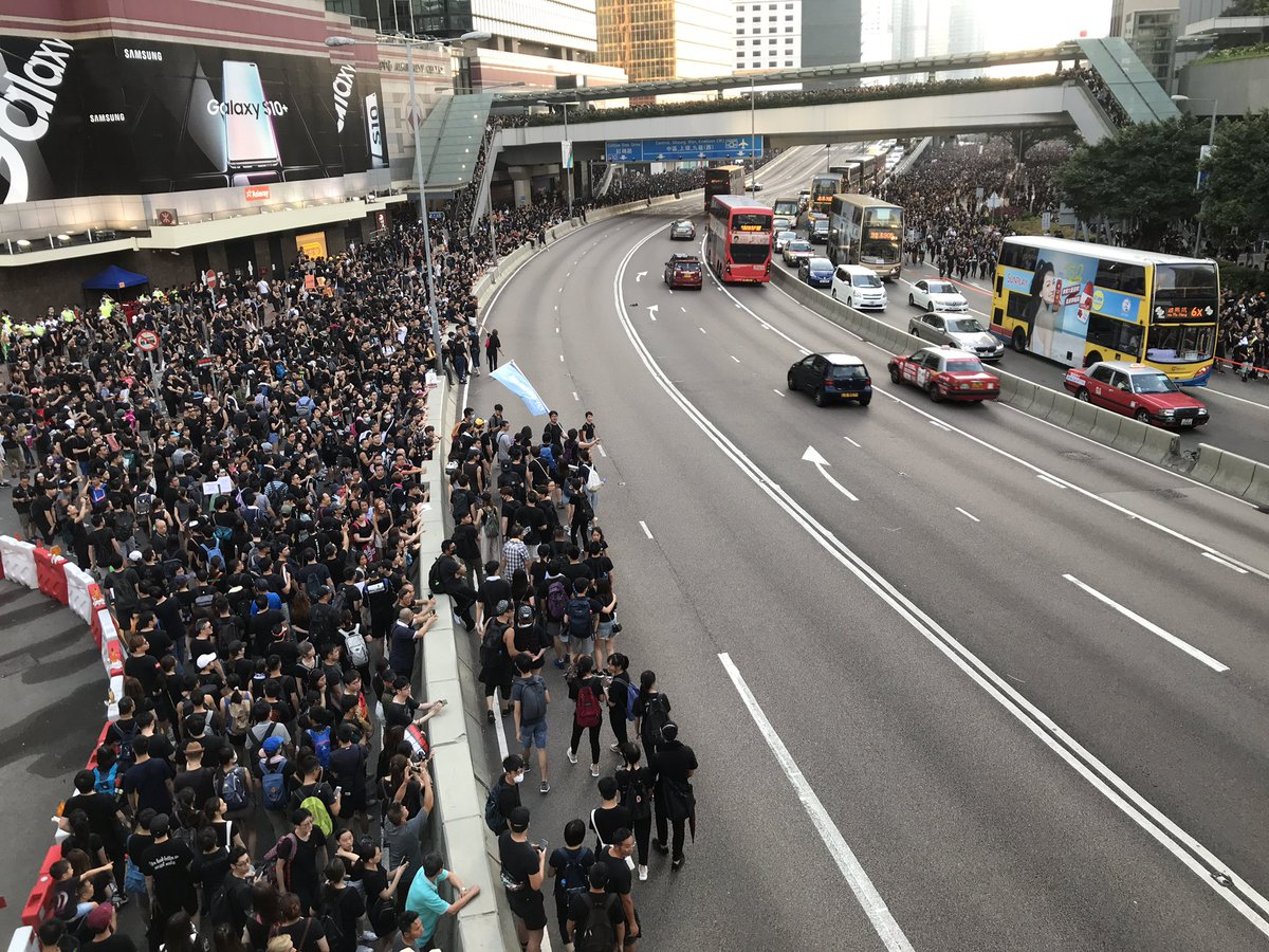 It started when a few protesters climbed onto the overpass on Harcourt Road. And people flooded in