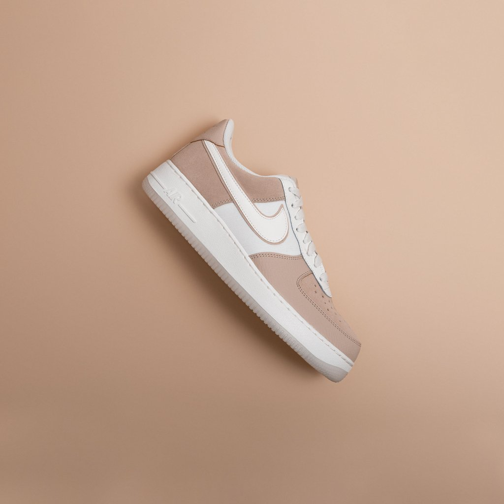 Sandy beach or sand-colored sneakers