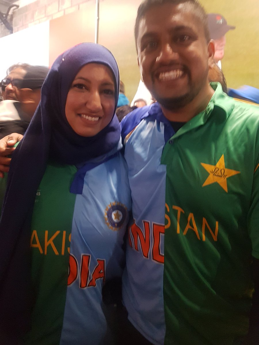 Spotted this couple at the #IndiaVsPakistan @cricketworldcup game and was intrigued by their jerseys! Husband is from Pakistan, wife from India so both stitched up India-Pak jerseys & wore them! Both are Canadians, watching the game in England, rooting for peace #SpiritofCricket