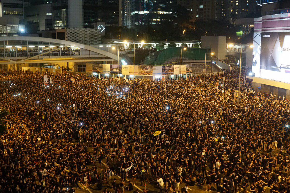 """BREAKING: Organisers have announced a turnout estimate of """"close to two million,"""" nearly doubling that of last Sunday's rally and making it the largest protest in Hong Kong's history. Police have yet to release their figure.  👉 In full: http://bit.ly/extraditionhk"""