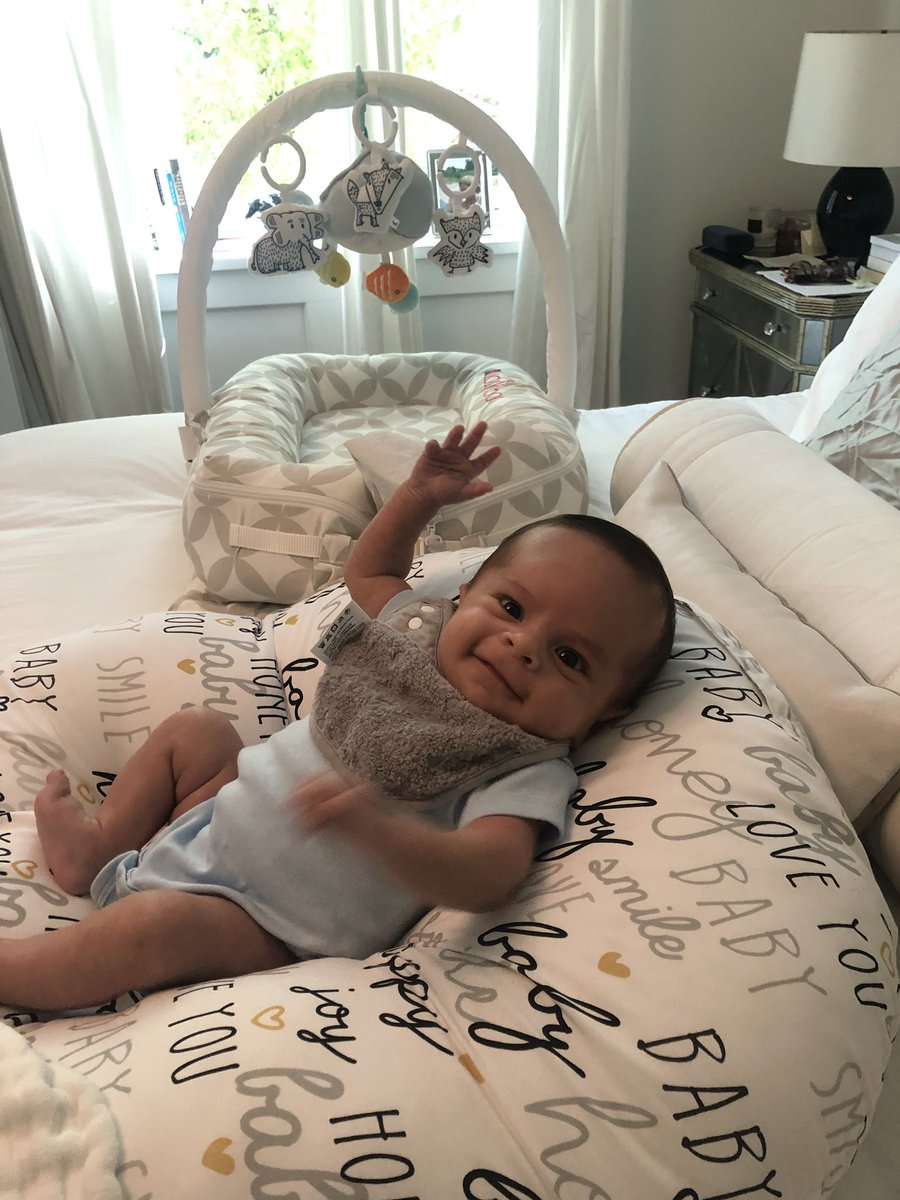 "Baby Moses giving ""Hi"" five to all the dads and all the men who are father figures in our lives. Moses And Papa. #happyfathersday to my ""Hubs"" on his First Father's day. Missing you my dad MSG Clarence Newton."