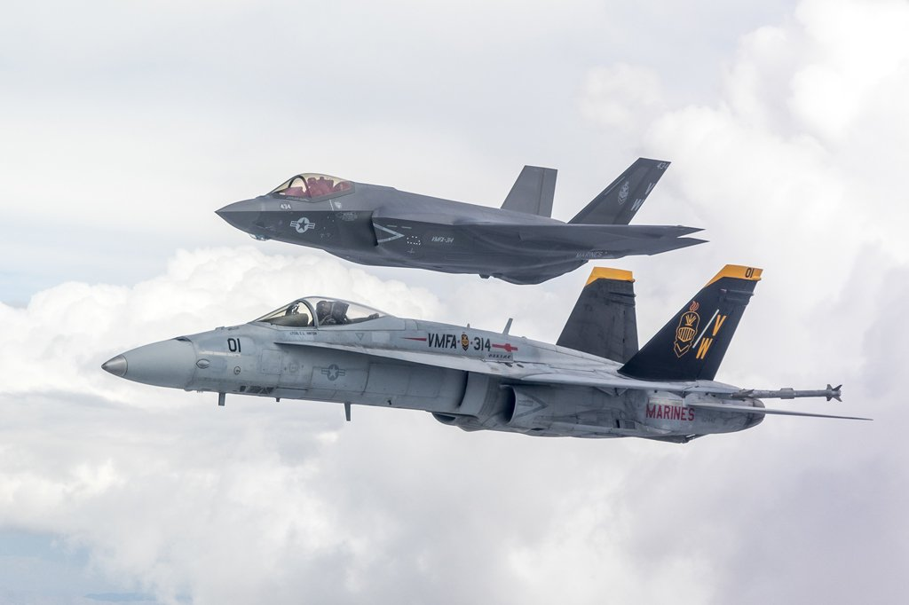 First VMFA-314 F-35C Flies In Formation With VMFA-314 F/A-18A++ Over Sierra Nevada As USMC Squadron Prepares To Retire Legacy Hornets. Story and photos:  https:// wp.me/p2TYIs-hdy    <br>http://pic.twitter.com/c2nMxU7Wko