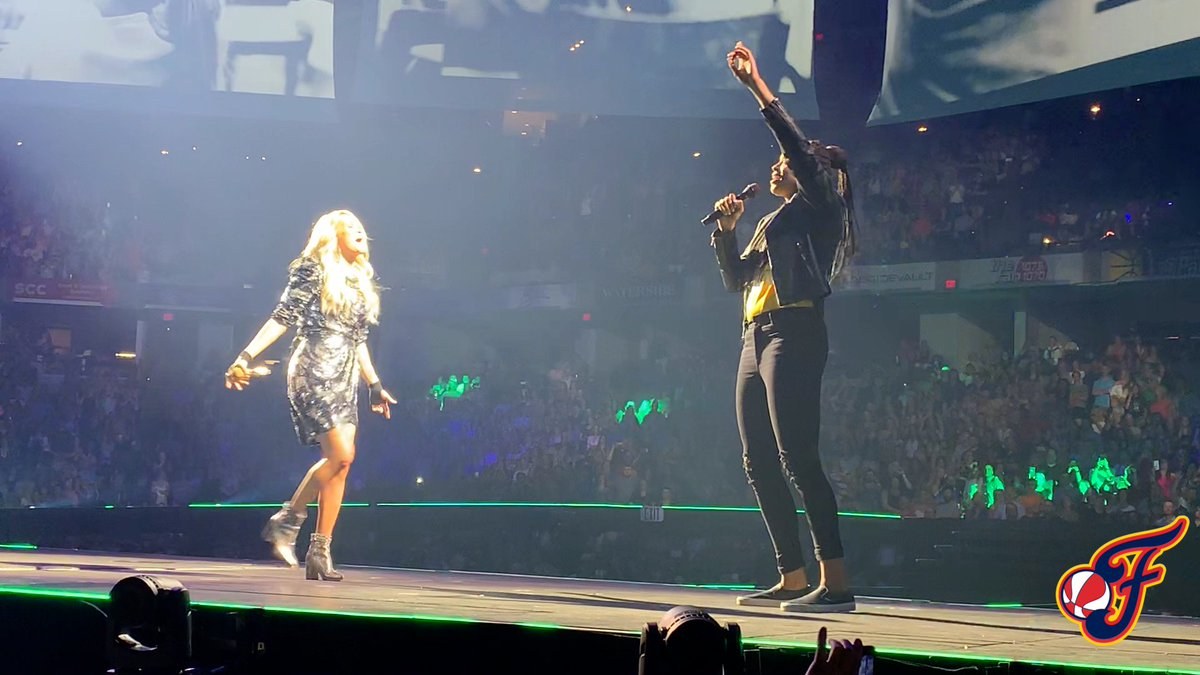 .@EricaMcCall24 on stage with @CarrieUnderwood is everything 🙌 (via @IndianaFever)