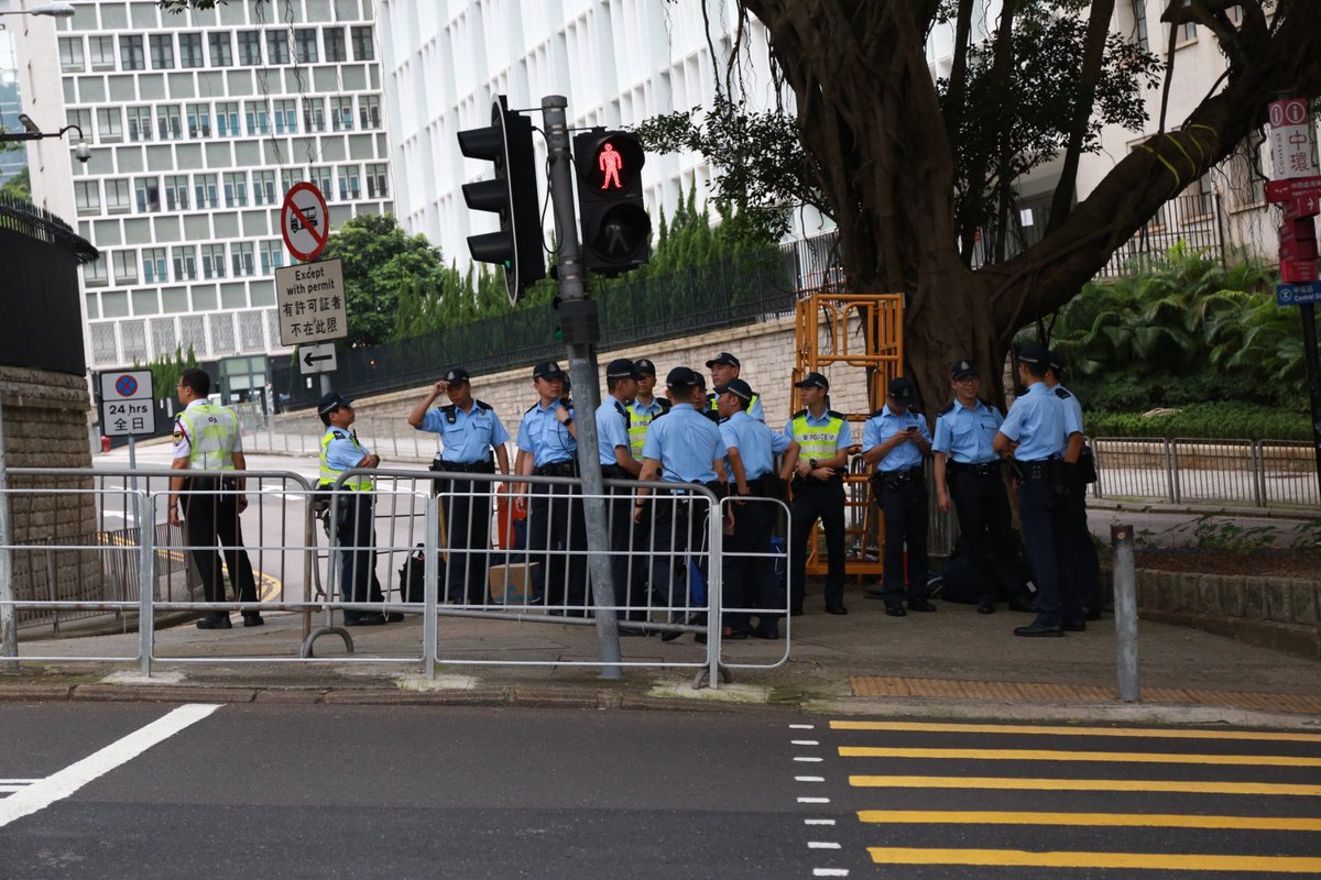 A group of police are stationed on Garden Road and barricades are placed on the narrow road leading up to the Government House.  No sign of protesters so far.