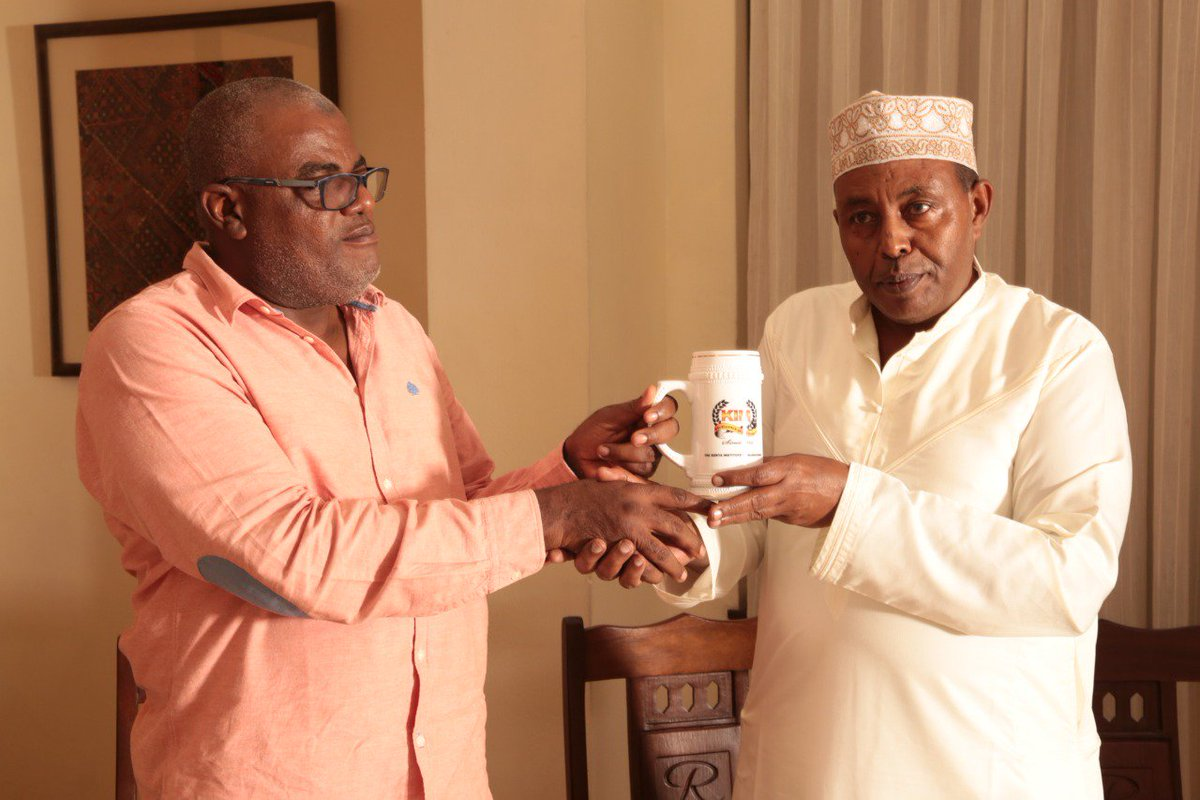 """K.I.M on Twitter: """"Hon Senator Mohamed Faki receives a Mug of Excellence from Acting chair of @KIMKenya Mombasa branch Mohamed Maalim during the #KIMMembersForum held at Royal Court Hotel on the 14th"""