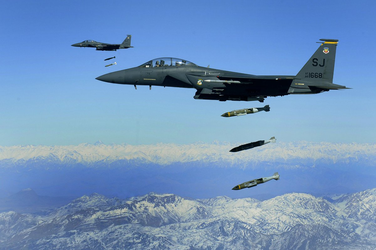 U.S. Air Force F-15E Strike Eagles, from the 335th Expeditionary Fighter Squadron, drop 2,000 pound Joint Direct Attack Munitions on a cave in eastern Afghanistan. /Staff Sgt. Michael B. Keller) <br>http://pic.twitter.com/7OKCclFMLL